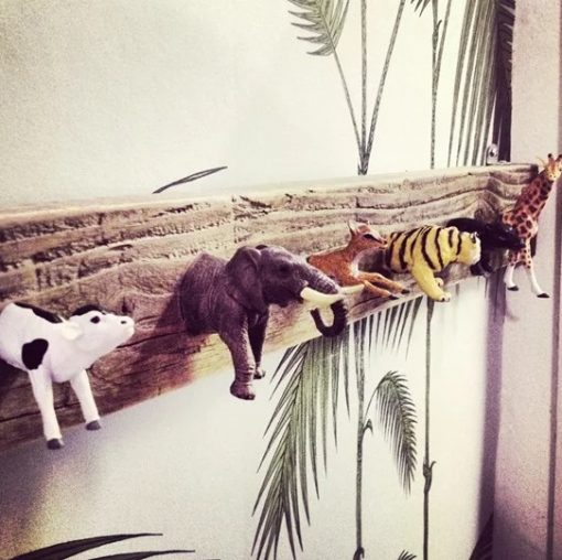 Plastic toy animals used as a coat rack
