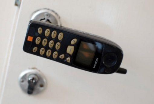 Old Nokia used as door handle