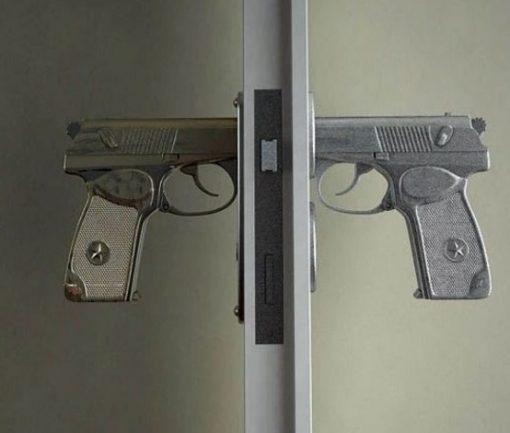 Gun inspired door handle