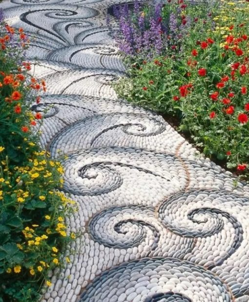 Garden path made of mosaic pebbles