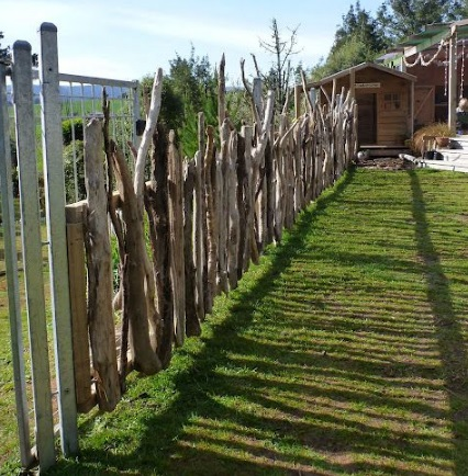 Twigs and Branches Transformed Into a Garden Fence