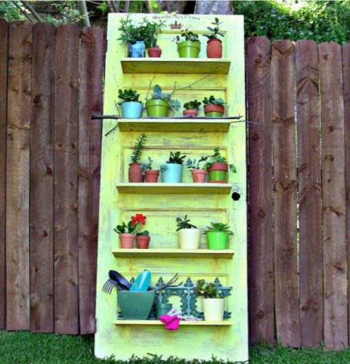 Door Repurposed Into a Garden Plant Shelf